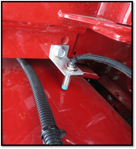 Proximity switch on unloading auger, helps track statistics per load